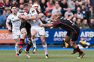 Gareth Anscombe (C) of the Cardiff Blues runs through Rynard Landman and Brok Harris of the Newport Gwent Dragons. Guinness Pro12 rugby match, Cardiff Blues v Newport Gwent Dragons at the Cardiff Arms Park in Cardiff, South Wales on Sunday 17th April 2016.<br /> pic by Simon Latham, Andrew Orchard sports photography.