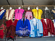 03 AUGUST 2019 - ST. PAUL, MINNESOTA: Hmong style clothes for sale in the Hmongtown Marketplace. Thousands of Hmong people, originally from the mountains of central Laos, settled in the Twin Cities in the late 1970s and early 1980s. Most were refugees displaced by the American war in Southeast Asia. According to the 2010 U.S. Census, there are now 66,000 ethnic Hmong in the Minneapolis-St. Paul area, making it the largest urban Hmong population in the world. There are two large Hmong markers in St. Paul. The Hmongtown Marketplace has are more than 125 shops, 11 restaurants, and a farmers' market in the summer. Hmong Village is newer and has more than 250 shops and 17 restaurants.     PHOTO BY JACK KURTZ