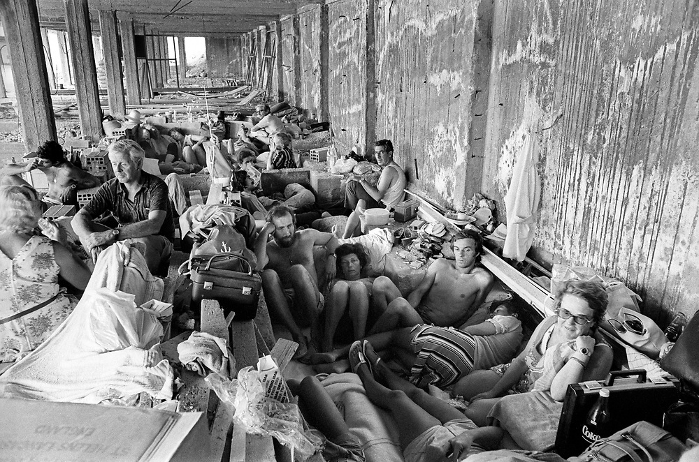 Cyprus War 20 July–18 August 1974. Turkish invasion of Cyprus code-name by Turkey, Operation Attila. British and German holiday makers shelter from Turkish air attacks and shelling in an underground garage below flats  in Kyrenia July 1974. Photo by Terry Fincher.