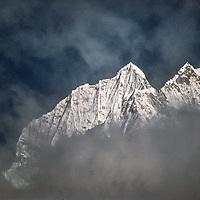 Clouds encircle Mount Thamserku in  the Khumbu Region in Nepal.