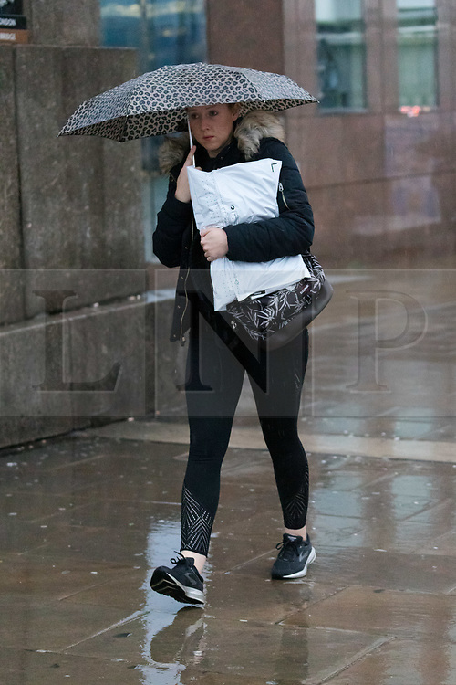 © Licensed to London News Pictures. 01/12/2018. London, UK.  A woman walking with an umbrella during rain and wet weather, near London Bridge on the first day of meteorological winter.  Photo credit: Vickie Flores/LNP