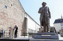 May 5, 2018 - Trier, Germany - Sculptor of the Karl Marx statue Wu Weishan delivers a speech during the unveiling ceremony of the Karl Marx statue in Trier, Germany. A China-donated statue of German philosopher Karl Marx was unveiled on Saturday in his birth town on the 200th anniversary of his birth. (Credit Image: © Shan Yuqi/Xinhua via ZUMA Wire)