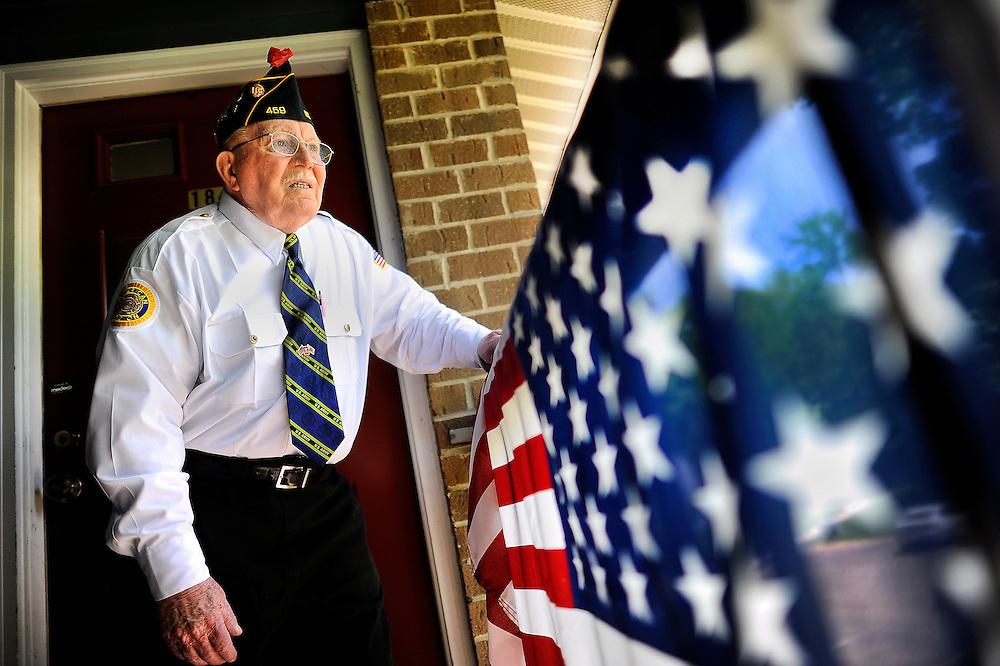 Korean War veteran Richard Pender stands outside his home in North Brunswick on May 14, 2015.