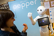 Journalist Hanna Sistek is interviewing Pepper, the first humanoid robot designed to live with humans and has the ability to read emotions. The robot is made by SoftBank Mobile and Aldebaran Robotics. Tokyo, Japan.<br /> Copyright 2015 CHRISTINA SJOGREN