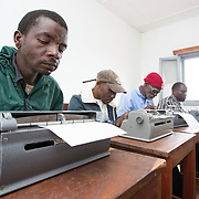 CAPTION: The PWD community faces discrimination on a daily basis. Access to schools, jobs and public services is often limited. Responding to adult literacy challenges by teaching Braille helps ACAMO members to develop active voices for dialogue with the government. It also serves as a method of rehabilitation, building hope for participants that they will eventually be able to return to regular employment and be re-integrated into the mainstream workforce. LOCATION: Lulimile Village, Lichinga, Niassa Province, Mozambique. INDIVIDUAL(S) PHOTOGRAPHED: From left to right: Anussa Wailesi, Rashid Matanque, Casimiro Adua Caisse and Amido Bonomar.