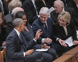 From left to right: former United States President Barack Obama, former first lady Michelle Obama, former US President Bill Clinton, and former US Secretary of State Hillary Rodham Clinton converse prior to the start of the National funeral service in honor of the late former US President George H.W. Bush at the Washington National Cathedral in Washington, DC on Wednesday, December 5, 2018.<br /> Photo by Ron Sachs / CNP/ABACAPRESS.COM