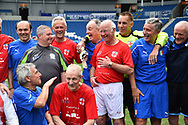 Tommy Charlton of England over 60's in the photo of the teams at full time during the world's first Walking Football International match between England and Italy at the American Express Community Stadium, Brighton and Hove, England on 13 May 2018. Picture by Graham Hunt.