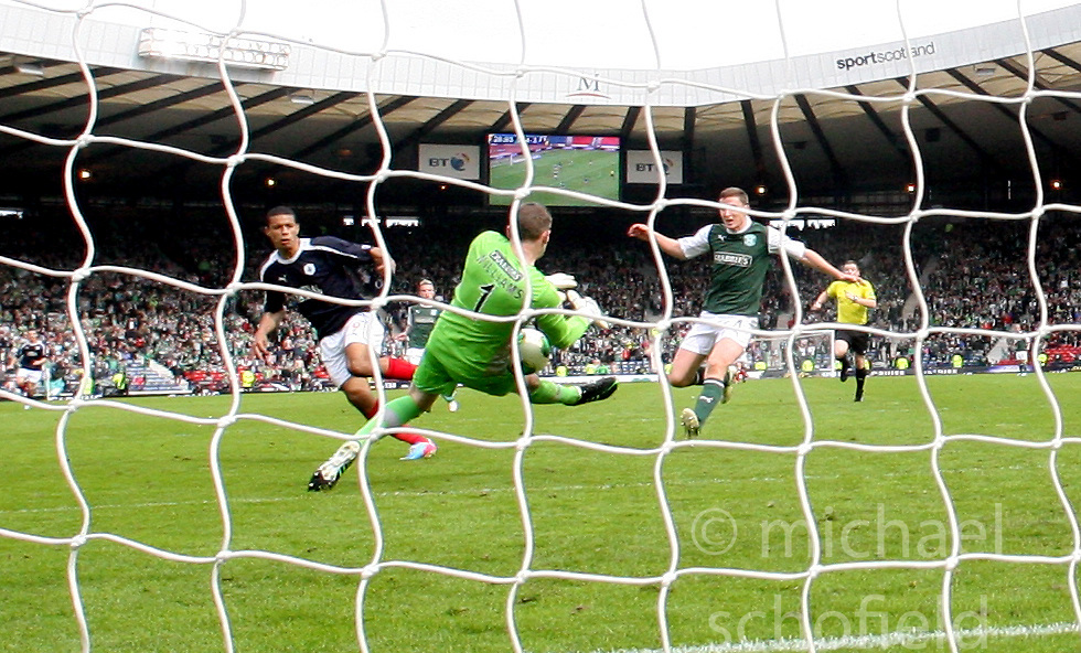 Falkirk's Lyle Taylor has his shot saved by Hibernian's keeper Ben Williams in the last minutes of extra-time..Hibernian 4 v 3 Falkirk, William Hill Scottish Cup Semi Final, Hampden Park...