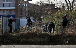 © licensed to London News Pictures. London, UK 08/03/2012. Police officers search bushes next to Regents Canal in east London where a torso, thought to be that of TV actress Gemma McCluskie's  was found yesterday. Photo credit: Tolga Akmen/LNP