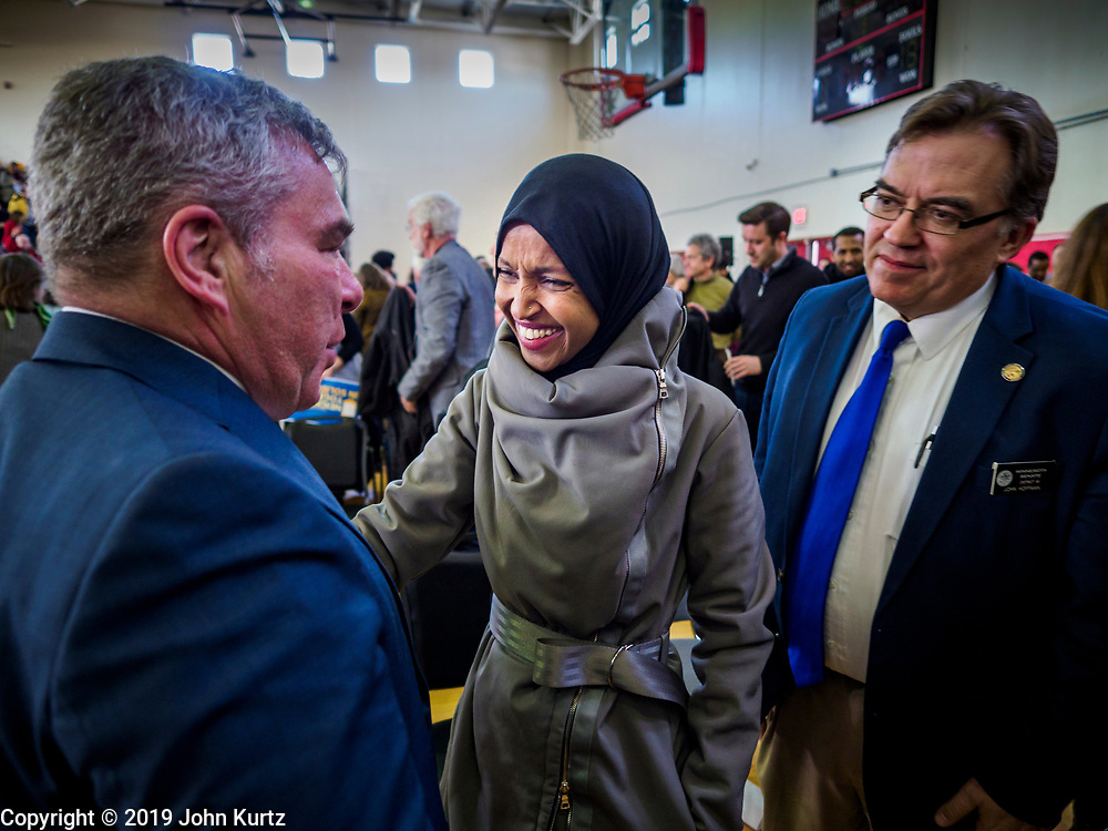 16 MARCH 2019 - BLOOMINGTON, MINNESOTA, USA: Congresswoman ILHAM OMAR (D-MN) (center) talks to other Minnesota politicians at Dar al Farooq Center in Bloomington. She is the first Somali-American elected to congress. An interdenominational crowd of about 1,000 people came to the center to protest white supremacy and religious intolerance and to support Muslims in New Zealand who were massacred by a white supremacist Friday. The Twin Cities has a large Muslim community following decades of Somali immigration to Minnesota. There are about 45,000 people of Somali descent in the Twin Cities.    PHOTO BY JACK KURTZ