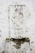 Highlander effigy on an outside wall of Old Ferry House, now a remote self-catering house at Grasspoint, Loch Don, Isle of Mull, Scotland. Until 1881 a regular packet boat operated from here between Oban and Grass Point.