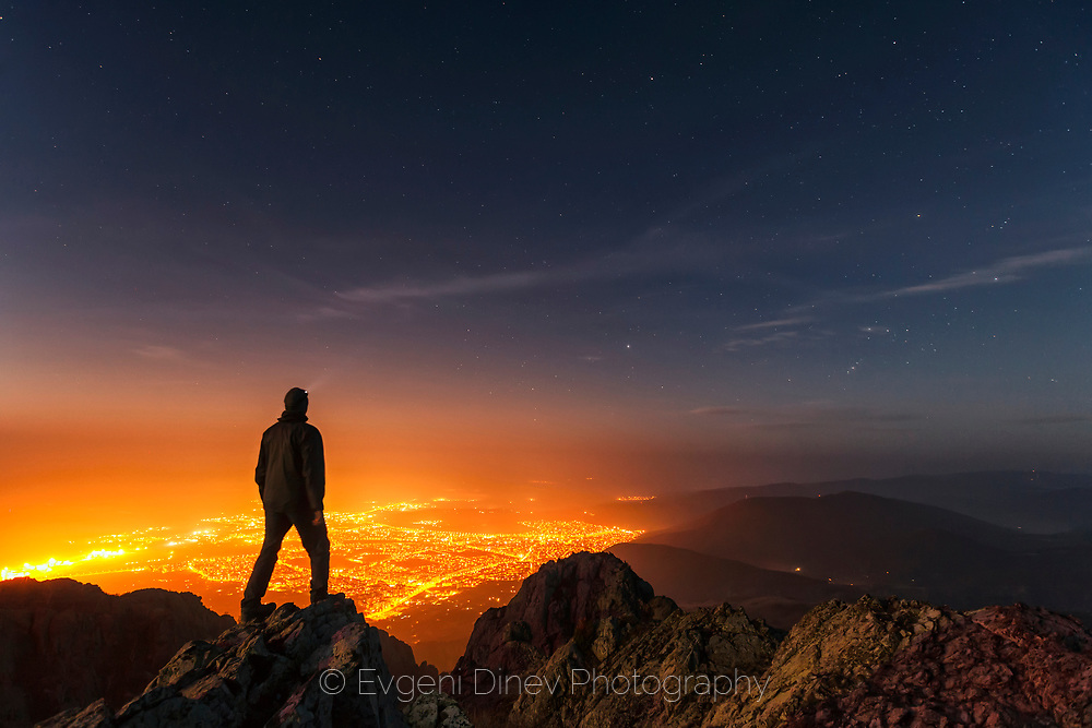 The light of town of Sliven at night. A view from Karandila peak. Self portrait.