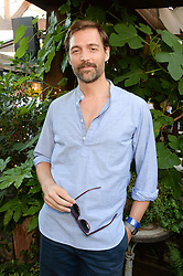 PATRICK GRANT attending the Warner Bros. & Esquire Summer Party held at Shoreditch House, Ebor Street, London E1 on 18th July 2013.