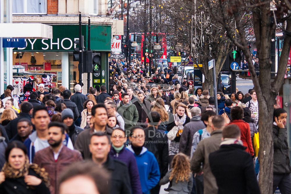 """London, December 23rd 2014. Dubbed by retailers as the """"Golden Hour"""" thousands of shoppers use their lunch hour to do some last minute Christmas shopping in London's West End. PICTURED: Thousands of shoppers cram Oxford Street as Christmas shopping reaches its crescendo."""