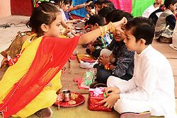 August 6, 2017 - Ajmer, Rajasthan, India - Women buy rakhi for their brothers in Ajmer, Rajasthan, India..Rajasthani children tie 'rakhi' on the wrist of a male classmate in celebration of Raksha Bandhan (Credit Image: © Shaukat Ahmed/Pacific Press via ZUMA Wire)