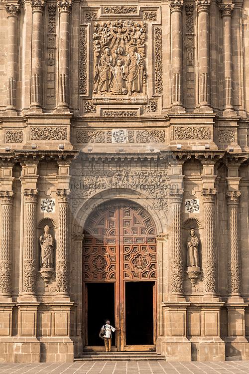 Facade and cantera stone portal of the Church of Santo Domingo in Santo Domingo plaza in the historic center of Mexico City, Mexico.