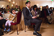 Sophia Mojadidi, 3, gets distracted as Joshua Kaye and others listen to a keynote presentation during the World Culture Festival Bay Area Curtain Raiser event at the India Community Center in Milpitas, California, on January 20, 2016. (Stan Olszewski/SOSKIphoto)
