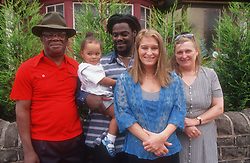 Multiracial family group with three generations,