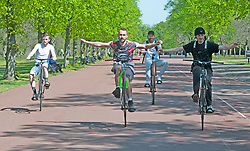 ©Licensed to London News Pictures 22/04/2020  <br /> Greenwich, UK. Young men performing wheelies while social distancing. People out and about in Greenwich park, Greenwich, London exercising and enjoying the warm sunny weather. Photo credit:Grant Falvey/LNP