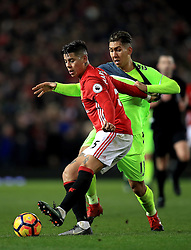 Manchester United's Marcos Rojo (left) and Liverpool's Roberto Firmino (Right) battle for the ball