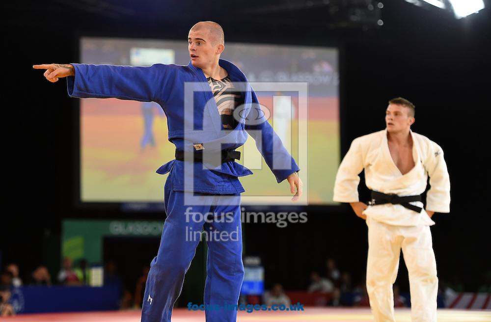 Danny Williams ENG (blue) points out that the clock has not been stopped during the mens 73k on day two of the judo at the  SECC Precinct, Glasgow<br /> Picture by Alan Stanford/Focus Images Ltd +44 7915 056117<br /> 25/07/2014