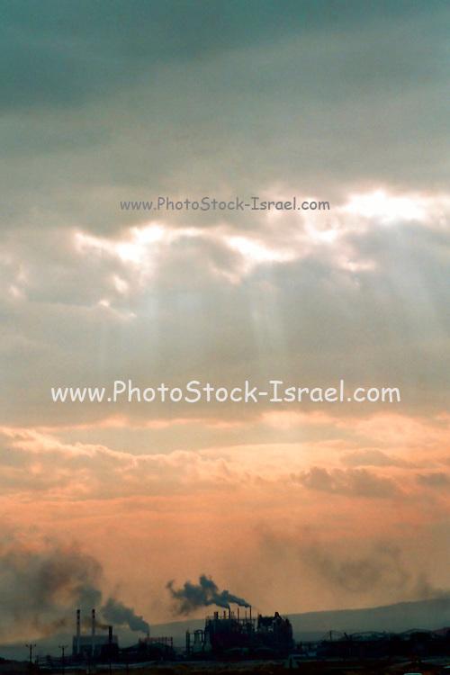 Israel; Dead Sea; sun set on an overcast day, over a chemical factory
