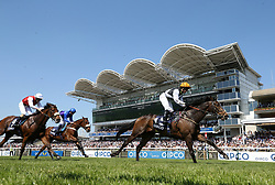 Maori Bob ridden by jockey Hayley Turner (right) in action in the Qatar Racing Handicap during day two of the QIPCO Guineas Festival at Newmarket Racecourse.