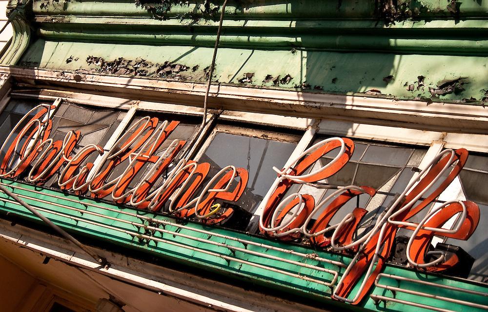 Peeling vintage neon signage outside Ovaltine Cafe, East Hastings Street, Vancouver BC