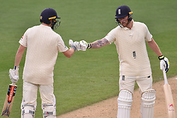 March 26, 2018 - Auckland, Auckland, New Zealand - Ben Stokes (R) and Chris Woakes (L) of England celebrate 50 runs partnership during Day Five of the First Test match between New Zealand and England at Eden Park in Auckland on Mar 26, 2018. (Credit Image: © Shirley Kwok/Pacific Press via ZUMA Wire)