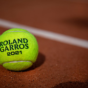 PARIS, FRANCE May 25. An official Roland Garros 2021 tournament tennis match ball on the clay court surface at the 2021 French Open Tennis Tournament at Roland Garros on May 25th 2021 in Paris, France. (Photo by Tim Clayton/Corbis via Getty Images)