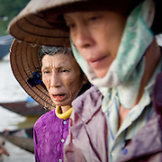 Old Vietnamese woman in traditional bamboo peasant hat (Hoi An, Vietnam - Nov. 2008) (Image ID: 081108-0652213a)