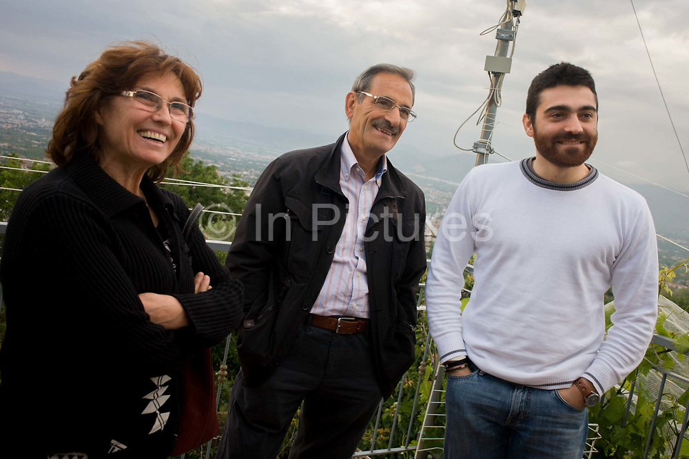 """Italian relatives on a rooftop of their home in the village of Somma Vesuviana, in the Red (evacuation) Zone on the western slope of Vesvius, Somma, Italy. The family have owned this land for generations, the family would choose to stay if the volcano erupts again. """"I was born here, I grew up here, I will die here, I've never been afraid here,"""" says one member. But Giuseppe Mastrolorenzo at the Vesuvius Volcano Observatory in Naples adds, """"There would be no modern precedent for an evacuation of this magnitude .. This is why Vesuvius is the most dangerous volcano in the world."""" From the chapter entitled 'Under the Volcano' and from the book 'Risk Wise: Nine Everyday Adventures' by Polly Morland (Allianz, The School of Life, Profile Books, 2015)."""