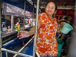 April 13, 2018 - Bangkok, Thailand - A woman in the back of songthaew (pickup truck converted to bus) gets hit with water during a water fight on Silom Road on the first day of Songkran in Bangkok. Songkran is the traditional Thai New Year celebration best known for water fights. (Credit Image: © Jack Kurtz via ZUMA Wire)