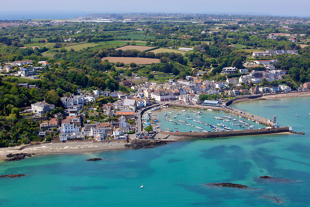 Aerial view of the harbour, beaches and houses in St Aubin, a popular tourist destination in Jersey, Channel Islands
