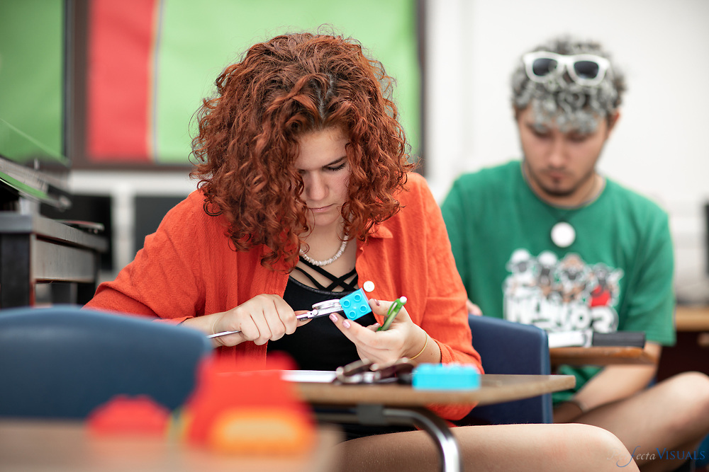 Students reverse engineer a building block in Jeffrey Gates' Project Lead the Way Engineering and Computer Programming class at Weaver Academy.<br /> <br /> Photographed, Monday, May 14, 2018, in Greensboro, N.C. JERRY WOLFORD and SCOTT MUTHERSBAUGH / Perfecta Visuals