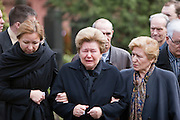 Moscow, Russia, 26/04/2007..Boris Yeltsin's widow Naina and daughters Yelena [black scarf] and Tatyana [dark glasses] make a private visit to to his grave the morning after the former Russian President was buried..