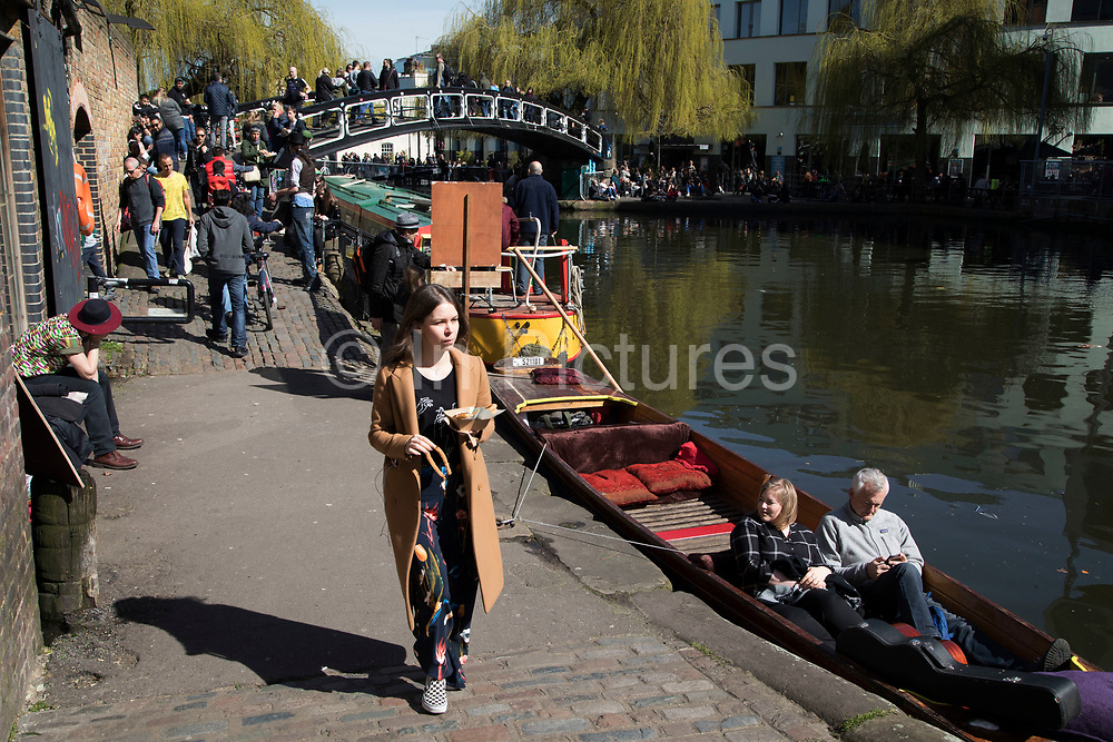 Boats and people at Camden Lock, a busy hang out for young Londoners and tourists in Camden Town, London, England, United Kingdom. Camden Town is famed for its market, warren of fashion and shops near Regent's Canal, and is a haven of alternative counter culture.