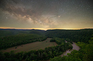 The early summer Milky Way can be seen above the bucolic Greenbrier River valley viewed from up high in the West Virginia mountains.