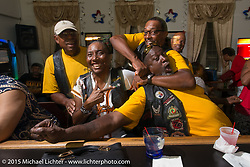 Flying Eagles MC members Jack Eldridge, Terri Collins, Stanley Myers and Archie Dennis ham it up at the bar during the club meetup at the American Legion in Catonsville, MD, USA. August 16, 2015.  Photography ©2015 Michael Lichter.
