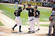 CHICAGO - MAY 22:  Juan PIerre #1 is greeted by Adam Dunn #32 of the Chicago White Sox after Pierre scored on a home run by Alexei Ramirez during the game against the Los Angeles Dodgers on May 22, 2011 at U.S. Cellular Field in Chicago, Illinois.  The White Sox defeated the Dodgers 8-3.  (Photo by Ron Vesely)  Subject:   Juan Pierre;Adam Dunn;Alexei Ramirez