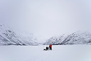 Ice-fishing on frozen lake in the Arctic Circle on Ringvassoya Island in the region of Tromso, Northern Norway