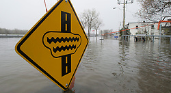 A road sign indicates water over the road in a flood zone, Monday, May 8, 2017 in Gatineau, Quebec, Canada. Photo by Adrian Wyld /The Canadian Press/ABACAPRESS.COM