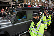 Demonstrators surround a Conservative Party car outside the Great Connaught Rooms where the Conservative Party Spring Conference was taking place and protesters gathered to protest against David Cameron's links to offshore finances on April 9th, 2016 in London, United Kingdom. Thousands of protesters gathered calling for the Prime Minister to resign and to protest over his recently revealed tax dealings in the Panama Papers'.