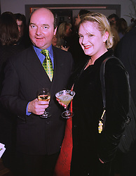 Gossip journalist MR ADAM HELLICKER and MISS VANESSA CORRINGHAM of the Diana, Princess of Wales Memorial Fund, at a party in London on 21st December 1998.MNB 48