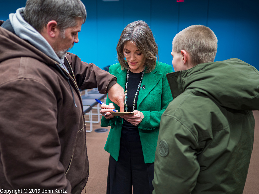 21 NOVEMBER 2019 - DES MOINES, IOWA: MARIANNE WILLIAMSON signs autographs for a man and his son after a campaign appearance at the Central Public Library in Des Moines. Williamson, an author, activist, and spiritual leader, is running to be the Democratic nominee for the US Presidency in the 2020 election.  Iowa hosts the first presidential selection event of the 2020 election cycle. The Iowa caucuses are on February 3, 2020.                   PHOTO BY JACK KURTZ