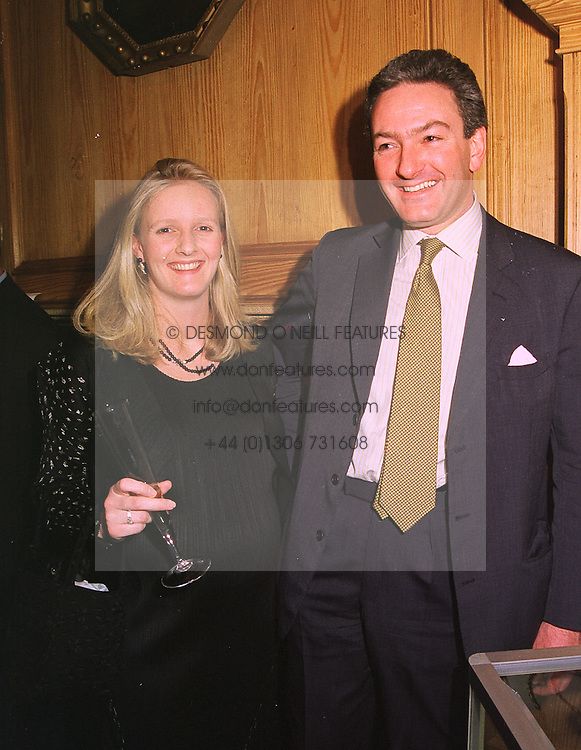 MR & MRS NICHOLAS WILLIAMS, she was Alexandra Heseltine, at a party in London on 27th January 1999.MNN 17