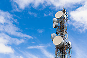 Urban provincial  cellular, microwave and telecom communications systems lattice tower under cloudy sky in Rockhampton, Queensland, Australia. <br /> <br /> Editions:- Open Edition Print / Stock Image