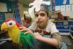 Child with physical disability having fun dressed up as a pirate,