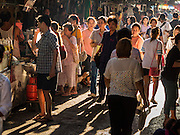 29 JUNE 2015 - BANGKOK, THAILAND:  People walk through the Bang Chak Market in Bangkok. The Bang Chak Market serves the community around Sois 91-97 on Sukhumvit Road in the Bangkok suburbs. About half of the market has been torn down, vendors in the remaining part of the market said they expect to be evicted by the end of the year. The old market, and many of the small working class shophouses and apartments near the market are being being torn down. People who live in the area said condominiums are being built on the land.    PHOTO BY JACK KURTZ