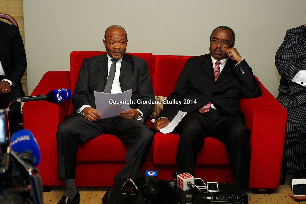PIETERMARITZBURG - 13 August 2014 - Senzo Mchunu (right) the premier releases the findings of a commission of inquiry into a December 2012 incident where eight potential recruits for the province's traffic police died during a fitness test. Seated next to him is Willies Mchunu, the province's MEC for transport, under whose department the Road Traffic Inspectorate falls. Picture: Allied Picture Press/APP